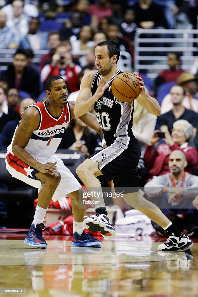 Manu Ginobili #20 of the San Antonio Spurs drives around <a gi-track='captionPersonalityLinkClicked' href=/galleries/search?phrase=Trevor+Ariza&family=editorial&specificpeople=201708 ng-click='$event.stopPropagation()'>Trevor Ariza</a> #1 of the Washington Wizards during the first half of their game at Verizon Center on November 26, 2012 in Washington, DC.