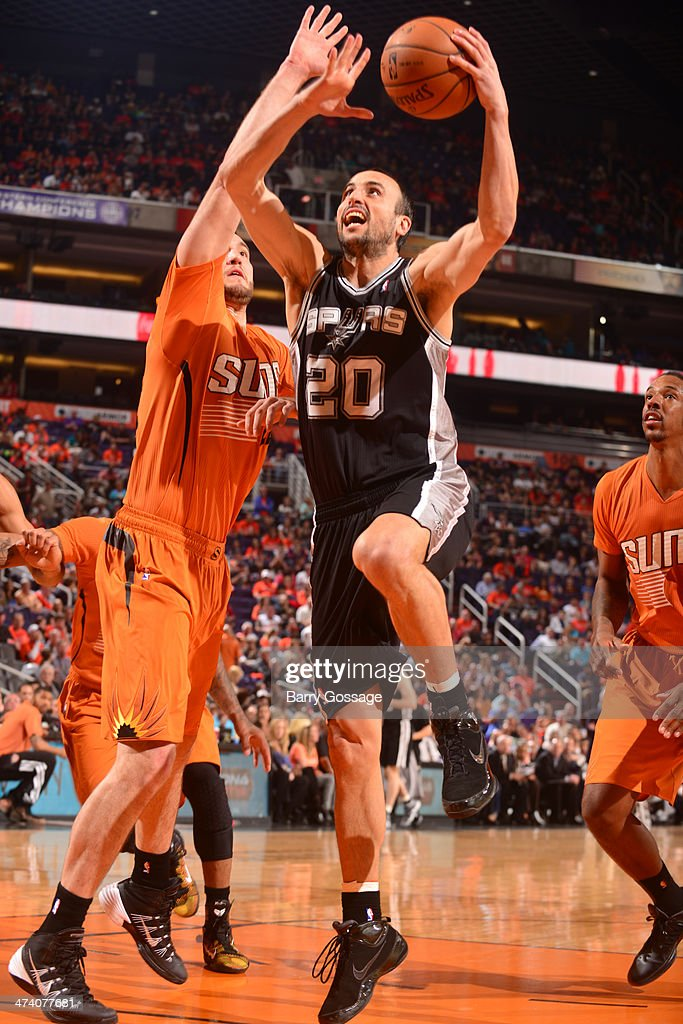 Manu Ginobili #20 of the San Antonio Spurs drives for a shot against Miles Plumlee #22 of the Phoenix Suns on February 21, 2014 at U.S. Airways Center in Phoenix, Arizona.