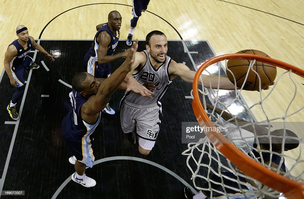 Manu Ginobili #20 of the San Antonio Spurs drives for a shot attempt against Darrell Arthur #00 of the Memphis Grizzlies during Game One of the Western Conference Finals of the 2013 NBA Playoffs at AT&T Center on May 19, 2013 in San Antonio, Texas.