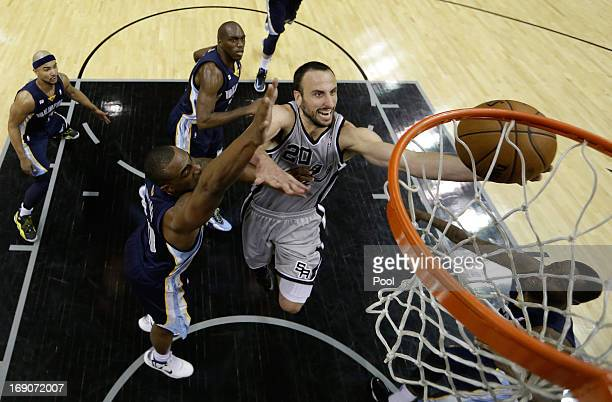 Manu Ginobili of the San Antonio Spurs drives for a shot attempt against Darrell Arthur of the Memphis Grizzlies during Game One of the Western...