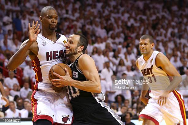 Manu Ginobili of the San Antonio Spurs drives on Chris Bosh of the Miami Heat in the fourth quarter during Game Seven of the 2013 NBA Finals at...