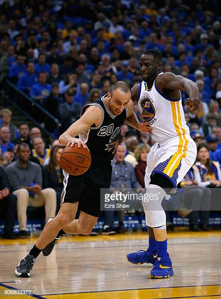 Manu Ginobili of the San Antonio Spurs drives on Draymond Green of the Golden State Warriors at ORACLE Arena on January 25 2016 in Oakland California...
