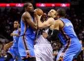 Manu Ginobili of the San Antonio Spurs drives on Kevin Durant and Russell Westbrook of the Oklahoma City Thunder in the first half in Game Two of the...