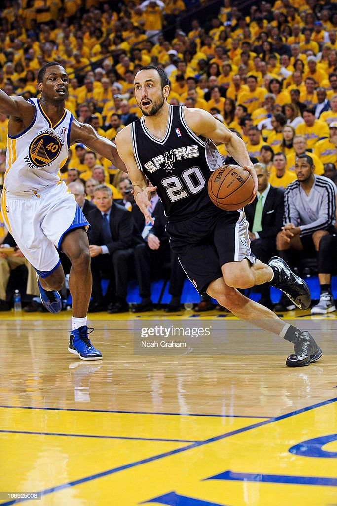 Manu Ginobili #20 of the San Antonio Spurs drives the baseline against Harrison Barnes #40 of the Golden State Warriors in Game Six of the Western Conference Semifinals during the 2013 NBA Playoffs on May 16, 2013 at Oracle Arena in Oakland, California.