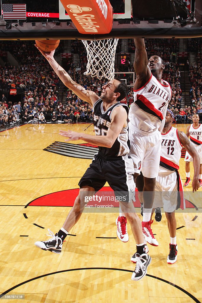 Manu Ginobili #20 of the San Antonio Spurs drives to the basket against <a gi-track='captionPersonalityLinkClicked' href=/galleries/search?phrase=J.J.+Hickson&family=editorial&specificpeople=4226173 ng-click='$event.stopPropagation()'>J.J. Hickson</a> #21 of the Portland Trail Blazers on November 10, 2012 at the Rose Garden Arena in Portland, Oregon.