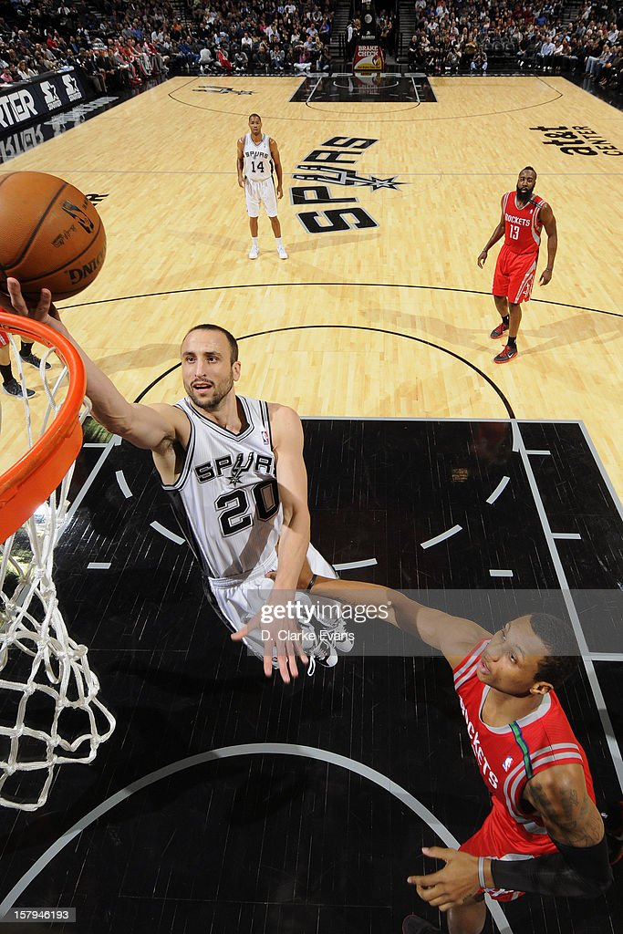 Manu Ginobili #20 of the San Antonio Spurs drives to the basket against the Houston Rockets on December 7, 2012 at the AT&T Center in San Antonio, Texas.