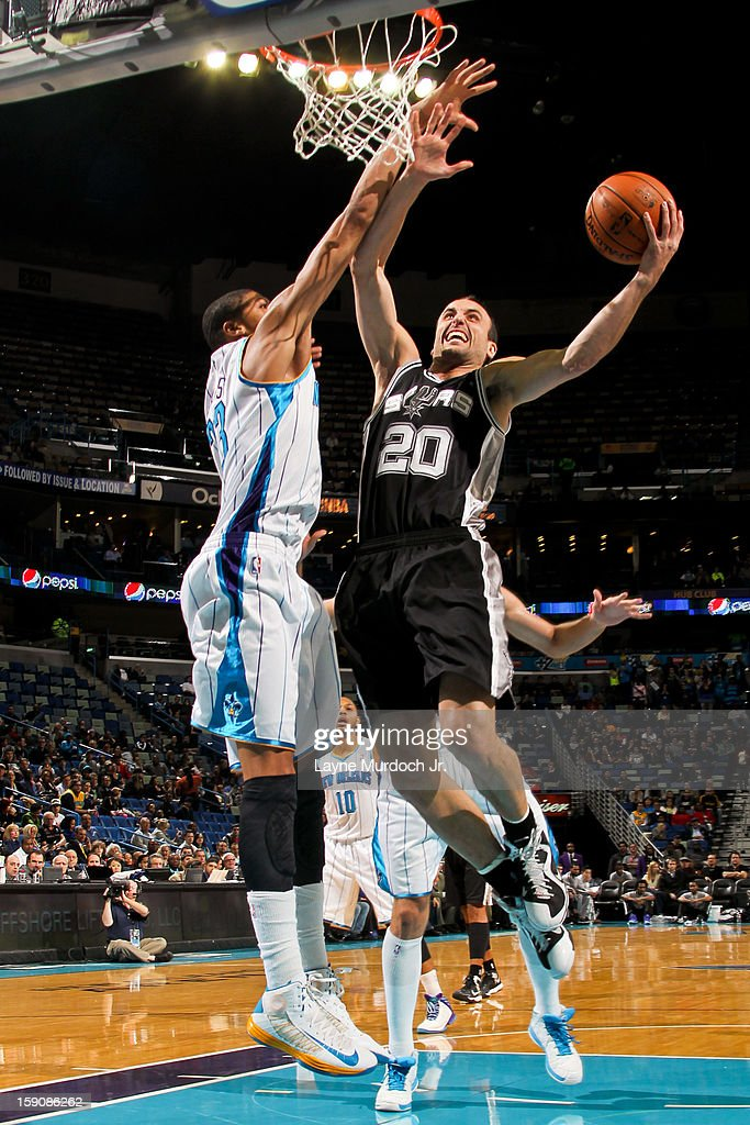 Manu Ginobili #20 of the San Antonio Spurs drives to the basket against Anthony Davis #23 of the New Orleans Hornets on January 7, 2013 at the New Orleans Arena in New Orleans, Louisiana.