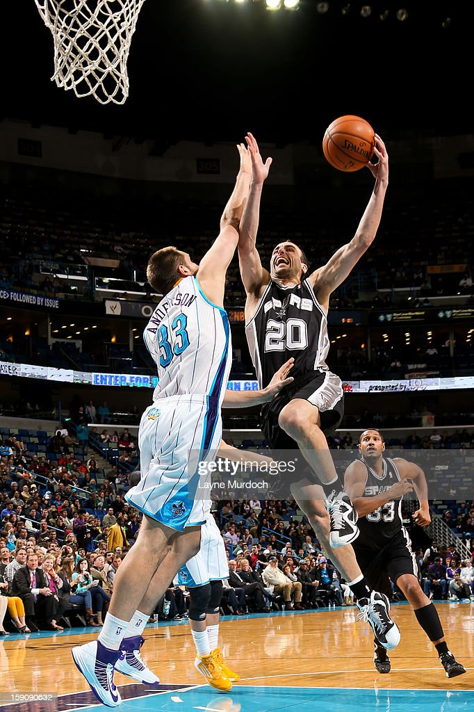 Manu Ginobili #20 of the San Antonio Spurs drives to the basket against Ryan Anderson #33 of the New Orleans Hornets on January 7, 2013 at the New Orleans Arena in New Orleans, Louisiana.