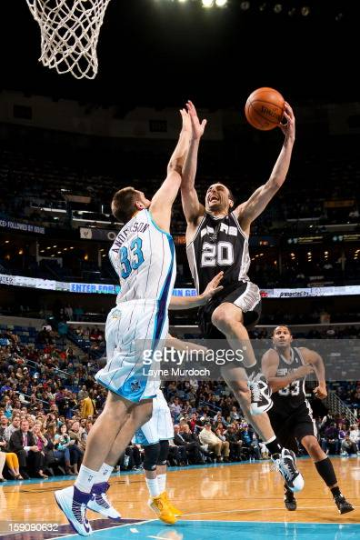 Manu Ginobili of the San Antonio Spurs drives to the basket against Ryan Anderson of the New Orleans Hornets on January 7 2013 at the New Orleans...