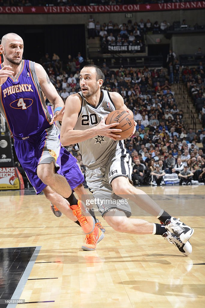 Manu Ginobili #20 of the San Antonio Spurs drives to the basket against Marcin Gortat #4 of the Phoenix Suns on January 26, 2013 at the AT&T Center in San Antonio, Texas.