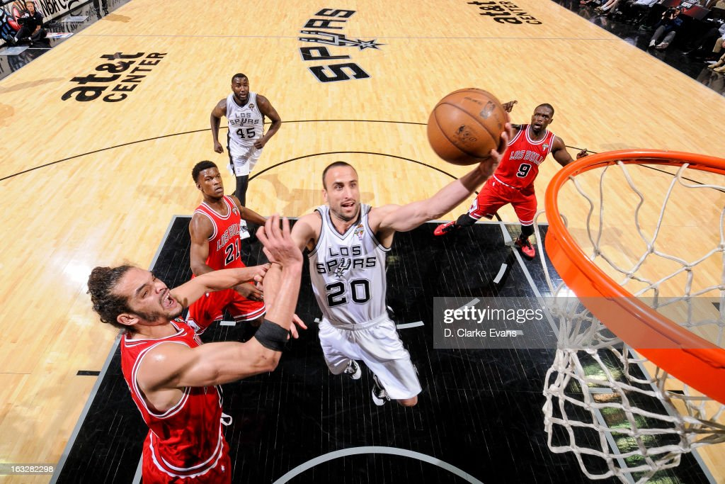 Manu Ginobili #20 of the San Antonio Spurs drives to the basket against Joakim Noah #13 of the Chicago Bulls on March 6, 2013 at the AT&T Center in San Antonio, Texas.