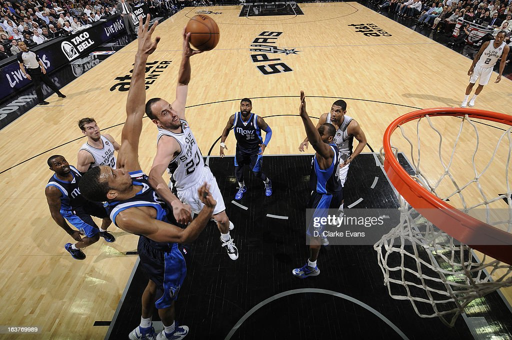 Manu Ginobili #20 of the San Antonio Spurs drives to the basket against the Dallas Mavericks on March 14, 2013 at the AT&T Center in San Antonio, Texas.