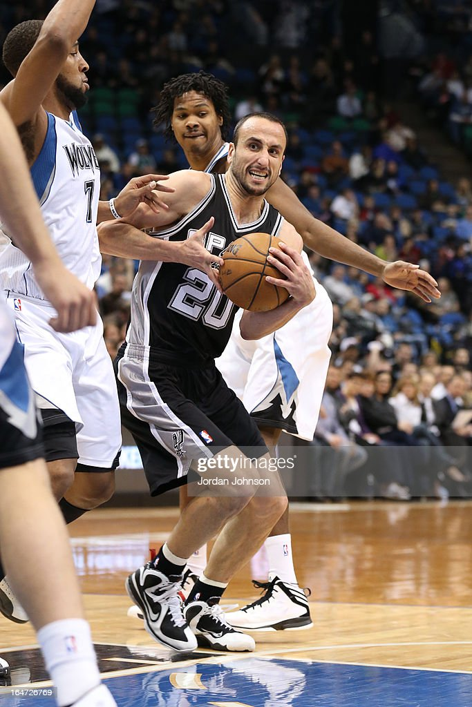 Manu Ginobili #20 of the San Antonio Spurs drives to the basket against the Minnesota Timberwolves on March 12, 2013 at Target Center in Minneapolis, Minnesota.