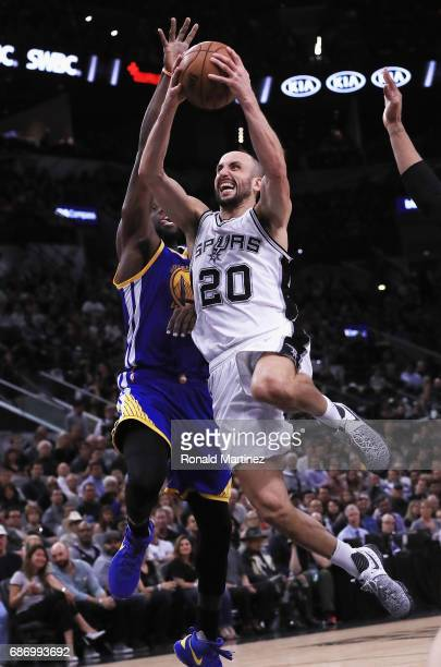 Manu Ginobili of the San Antonio Spurs drives to the basket against Draymond Green of the Golden State Warriors in the second half during Game Four...