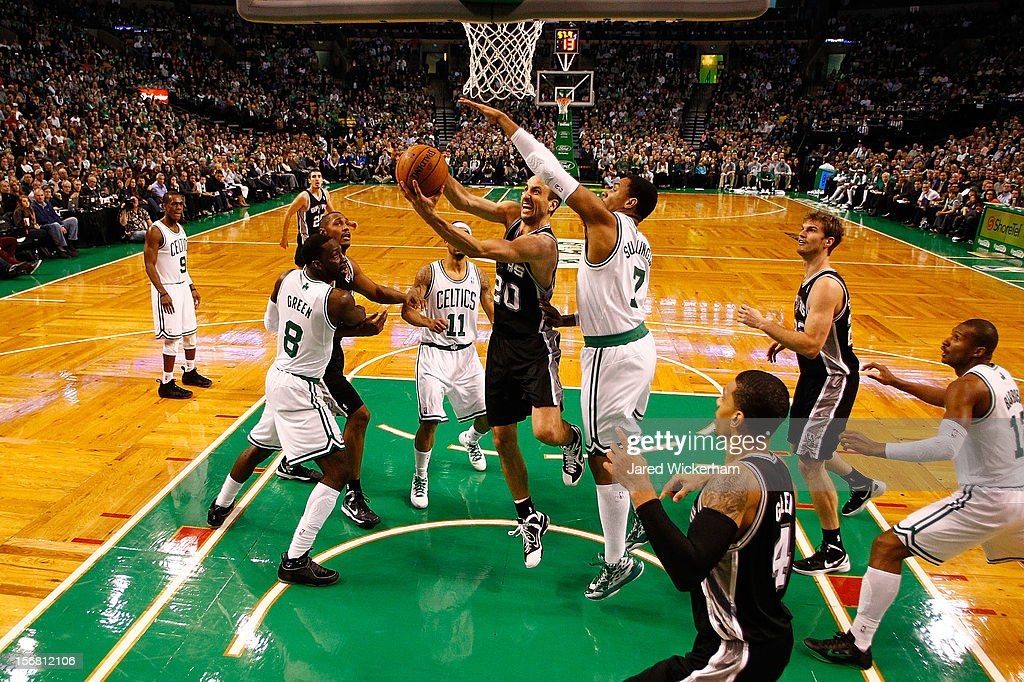 Manu Ginobili #20 of the San Antonio Spurs drives to the basket for a layup in front of Jared Sullinger #7 of the Boston Celtics during the game on November 21, 2012 at TD Garden in Boston, Massachusetts.