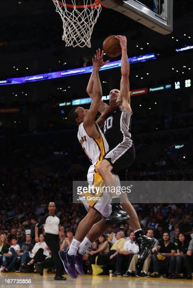 Manu Ginobili of the San Antonio Spurs drives to the basket while defended by Andrew Goudelock of the Los Angeles Lakers in the first half during...