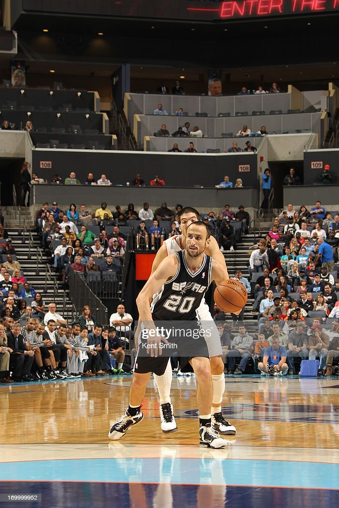 Manu Ginobili #20 of the San Antonio Spurs drives to the hoop against the Charlotte Bobcats at the Time Warner Cable Arena on December 8, 2012 in Charlotte, North Carolina.