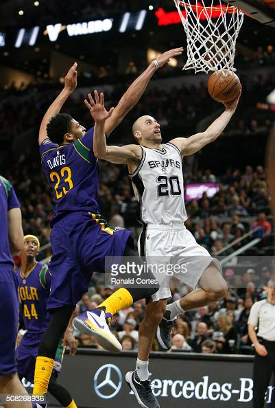 Manu Ginobili of the San Antonio Spurs drives under Anthony Davis of the New Orleans Pelicans at ATT Center on February 3 2016 in San Antonio Texas...