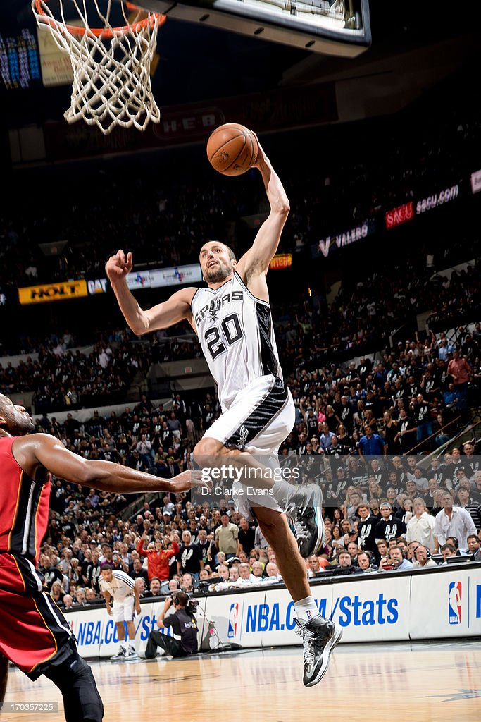 Manu Ginobili #20 of the San Antonio Spurs dunks against <a gi-track='captionPersonalityLinkClicked' href=/galleries/search?phrase=Dwyane+Wade&family=editorial&specificpeople=201481 ng-click='$event.stopPropagation()'>Dwyane Wade</a> #3 of the Miami Heat during Game Three of the 2013 NBA Finals on June 11, 2013 at AT&T Center in San Antonio, Texas.