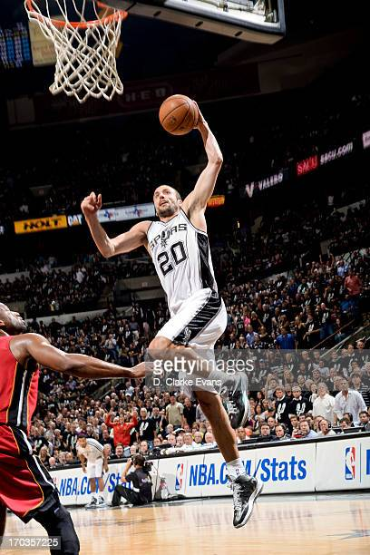 Manu Ginobili of the San Antonio Spurs dunks against Dwyane Wade of the Miami Heat during Game Three of the 2013 NBA Finals on June 11 2013 at ATT...