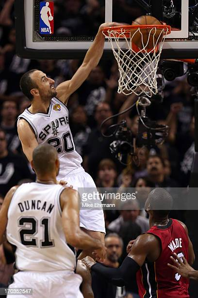 Manu Ginobili of the San Antonio Spurs dunks the ball in the third quarter while taking on the Miami Heat during Game Three of the 2013 NBA Finals at...
