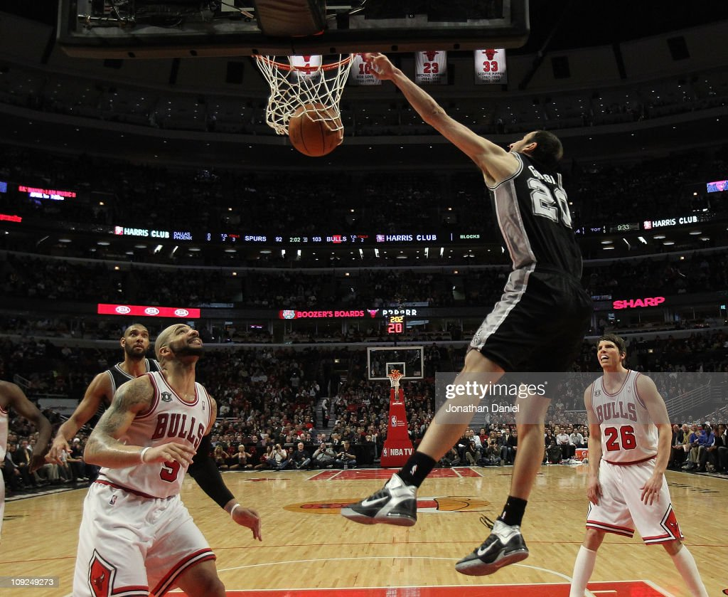 Manu Ginobili #20 of the San Antonio Spurs dunks the ball over <a gi-track='captionPersonalityLinkClicked' href=/galleries/search?phrase=Carlos+Boozer&family=editorial&specificpeople=201638 ng-click='$event.stopPropagation()'>Carlos Boozer</a> #5 of the Chicago Bulls at the United Center on February 17, 2011 in Chicago, Illinois. The Bulls defeated the Spurs 109-99.