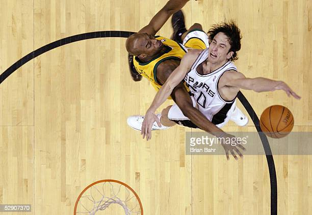 Manu Ginobili of the San Antonio Spurs gets flattened by Damien Wilkins of the Seattle SuperSonics for a flagrant foul in Game five of the Western...