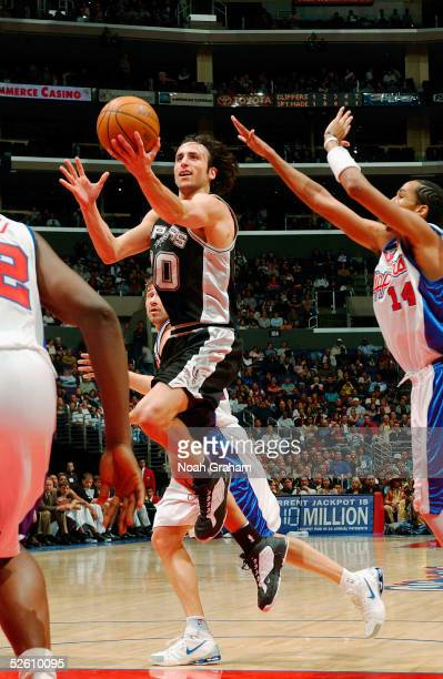 Manu Ginobili of the San Antonio Spurs goes strong to the hoop against Shaun Livingston of the Los Angeles Clippers on April 9 2005 at the Staples...