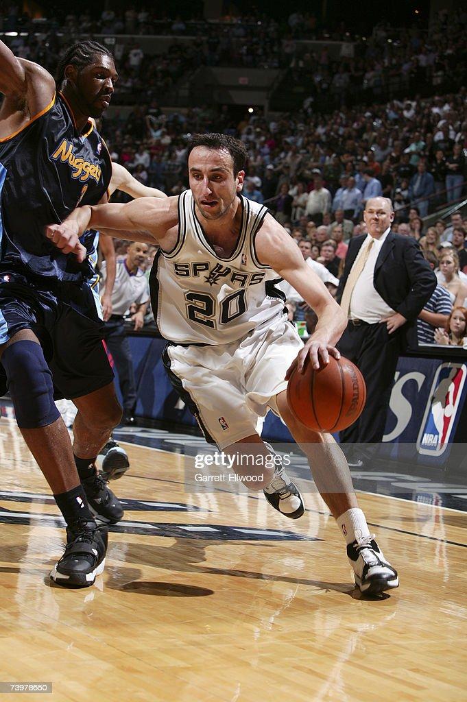 Manu Ginobili #20 of the San Antonio Spurs goes to the basket against Nene #31 of the Denver Nuggets in Game Two of the Western Conference Quarterfinals during the 2007 NBA Playoffs at AT&T Center on April 25, 2007 in San Antonio, Texas.