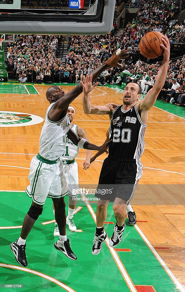 Manu Ginobili #20 of the San Antonio Spurs goes to the basket against Kevin Garnett #5 of the Boston Celtics on November 21, 2012 at the TD Garden in Boston, Massachusetts.