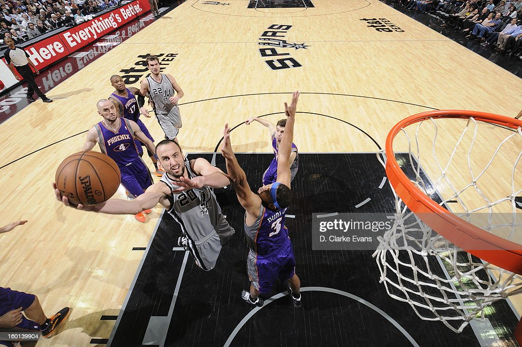 Manu Ginobili #20 of the San Antonio Spurs goes to the basket against Jared Dudley #3 of the Phoenix Suns on January 26, 2013 at the AT&T Center in San Antonio, Texas.