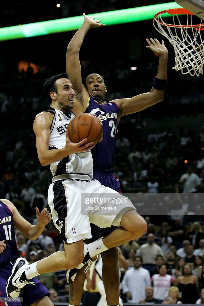 Manu Ginobili #20 of the San Antonio Spurs goes to the basket against Donyell Marshall #24 of the Cleveland Cavaliers in Game Two of the 2007 NBA Finals on June 10, 2007 at the AT&T Center in San Antonio, Texas.