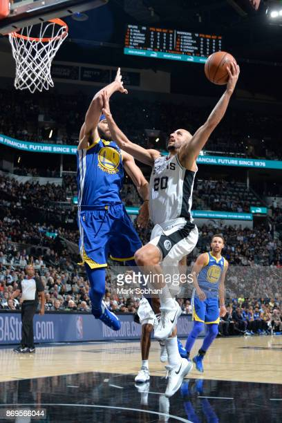 Manu Ginobili of the San Antonio Spurs goes to the basket against JaVale McGee of the Golden State Warriors on November 2 2017 at the ATT Center in...
