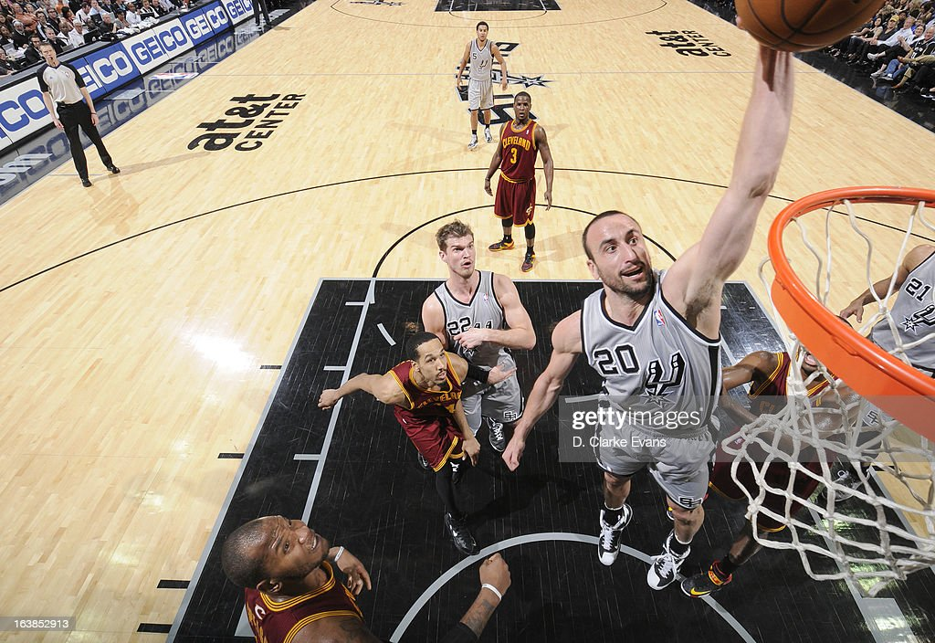 Manu Ginobili #20 of the San Antonio Spurs goes to the basket during the game between the Cleveland Cavaliers and the San Antonio Spurs on March 16, 2013 at the AT&T Center in San Antonio, Texas.