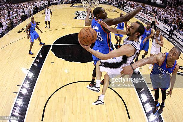 Manu Ginobili of the San Antonio Spurs goes to the hoop against Kevin Durant and Russell Westbrook of the Oklahoma City Thunder in Game Five of the...