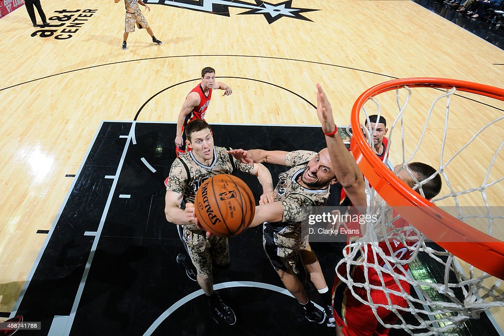Manu Ginobili of the San Antonio Spurs goes up for a reverse layup against the New Orleans Pelicans at the ATT Center on November 8 2014 in San...