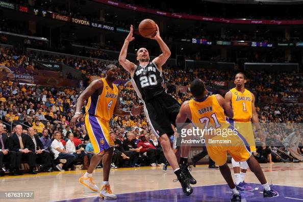 Manu Ginobili of the San Antonio Spurs goes up for a shot against Antawn Jamison and Chris Duhon of the Los Angeles Lakers at Staples Center in Game...