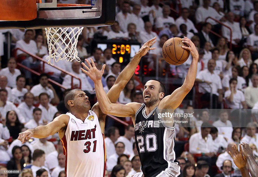 Manu Ginobili #20 of the San Antonio Spurs goes up for a shot against Shane Battier #31 of the Miami Heat in the first half during Game One of the 2013 NBA Finals at AmericanAirlines Arena on June 6, 2013 in Miami, Florida.