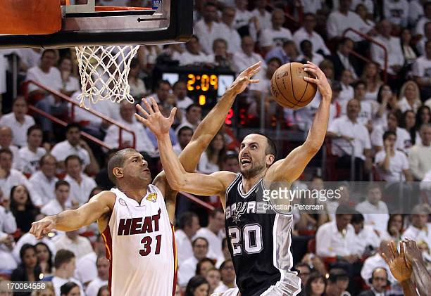 Manu Ginobili of the San Antonio Spurs goes up for a shot against Shane Battier of the Miami Heat in the first half during Game One of the 2013 NBA...