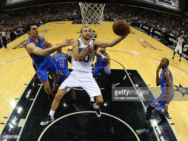 Manu Ginobili of the San Antonio Spurs goes up for a shot against Steven Adams of the Oklahoma City Thunder in the fourth quarter in Game One of the...