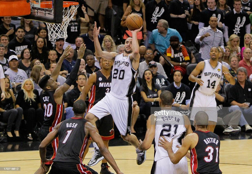 Manu Ginobili #20 of the San Antonio Spurs goes up for a shot over Norris Cole #30 of the Miami Heat in the second half during Game Five of the 2013 NBA Finals at the AT&T Center on June 16, 2013 in San Antonio, Texas.