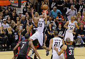 Manu Ginobili of the San Antonio Spurs goes up for a shot over Norris Cole of the Miami Heat in the second half during Game Five of the 2013 NBA...