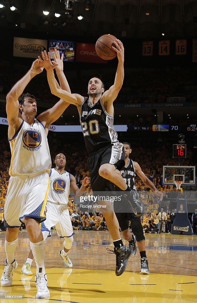 Manu Ginobili #20 of the San Antonio Spurs goes up for the shot against Andrew Bogut #12 of the Golden State Warriors in Game Four of the Western Conference Semifinals during the 2013 NBA Playoffs on May 12, 2013 at Oracle Arena in Oakland, California.