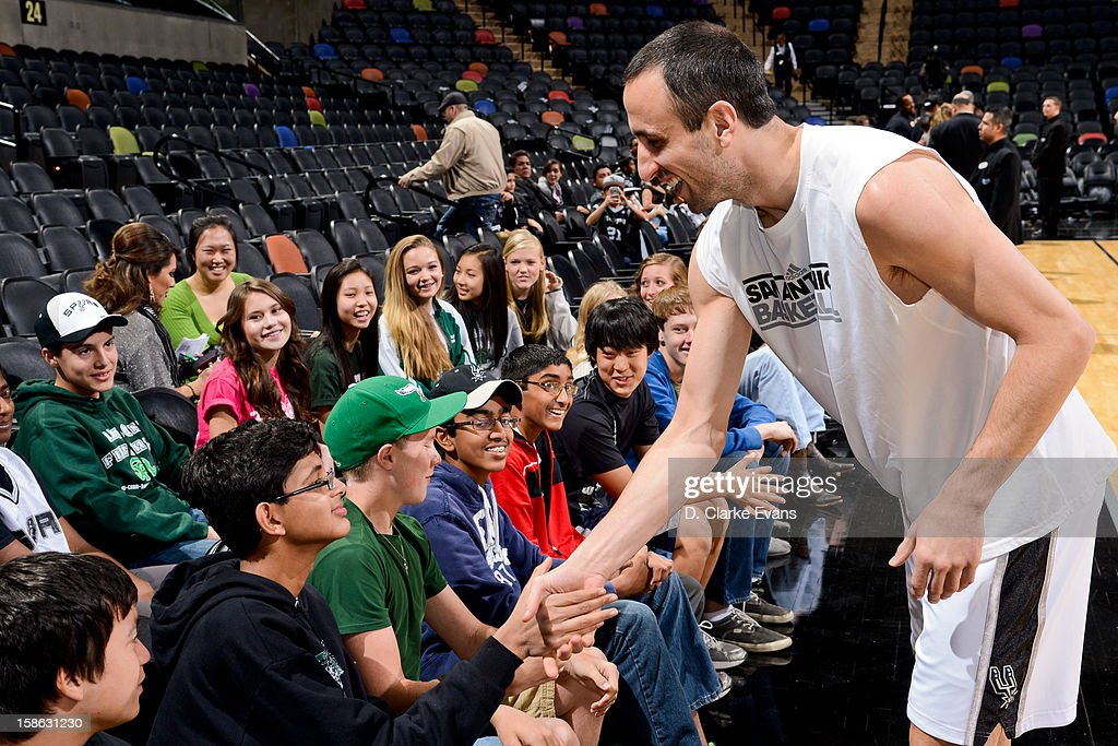 Manu Ginobili #20 of the San Antonio Spurs greets fans before a game against the New Orleans Hornets on December 21, 2012 at the AT&T Center in San Antonio, Texas.