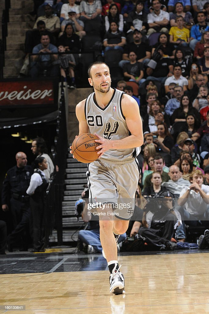 Manu Ginobili #20 of the San Antonio Spurs handles the ball up-court against the Phoenix Suns on January 26, 2013 at the AT&T Center in San Antonio, Texas.