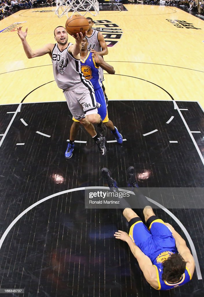 Manu Ginobili #20 of the San Antonio Spurs is called for a charge against <a gi-track='captionPersonalityLinkClicked' href=/galleries/search?phrase=Andrew+Bogut&family=editorial&specificpeople=207105 ng-click='$event.stopPropagation()'>Andrew Bogut</a> #12 of the Golden State Warriors during Game Two of the Western Conference Semifinals of the 2013 NBA Playoffs at AT&T Center on May 8, 2013 in San Antonio, Texas.