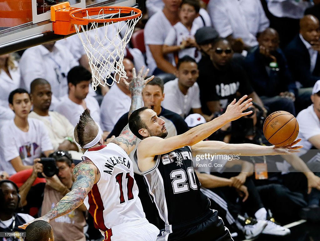 Manu Ginobili #20 of the San Antonio Spurs is fouled by Chris Andersen #11 of the Miami Heat in the third quarter during Game Seven of the 2013 NBA Finals at AmericanAirlines Arena on June 20, 2013 in Miami, Florida.