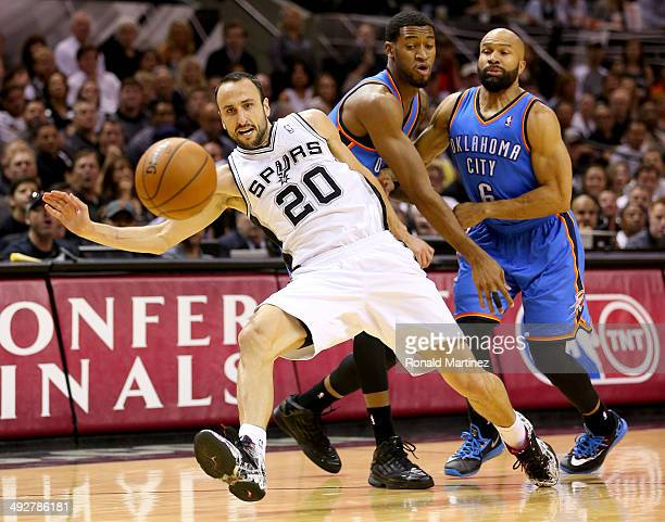 Manu Ginobili of the San Antonio Spurs is fouled by Derek Fisher of the Oklahoma City Thunder in the first half in Game Two of the Western Conference...