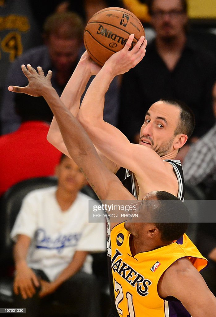 Manu Ginobili (L) of the San Antonio Spurs is guarded by Chris Duhon (R) of the Los Angeles Lakers during Game Three of the NBA Western Conference Quarterfinal Playoffs at Staples Center in Los Angeles, California on April 26, 2013. AFP PHOTO / Frederic J. BROWN