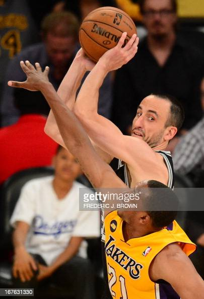 Manu Ginobili of the San Antonio Spurs is guarded by Chris Duhon of the Los Angeles Lakers during Game Three of the NBA Western Conference...